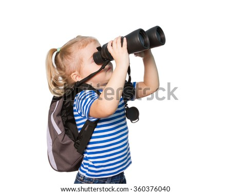 Little Funny girl in striped shirt  looking through binoculars. Isolated on white background - stock photo