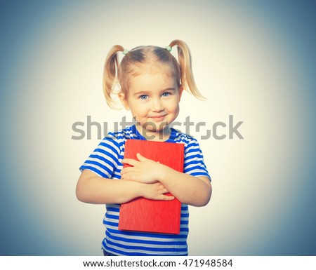 Little Funny girl in striped shirt with books. Isolated on background