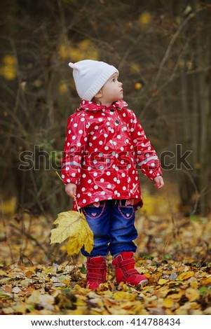 little funny girl with yellow leaf