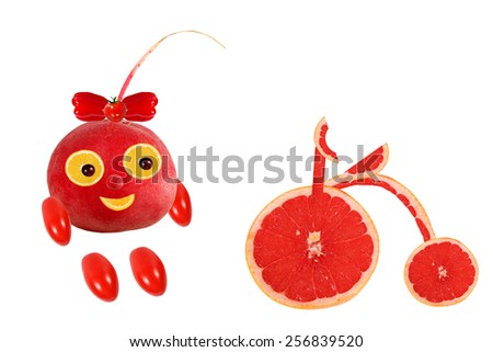Little funny  radish stands  with a retro bicycle - stock photo