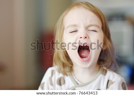 Little funny toddler girl screaming - stock photo