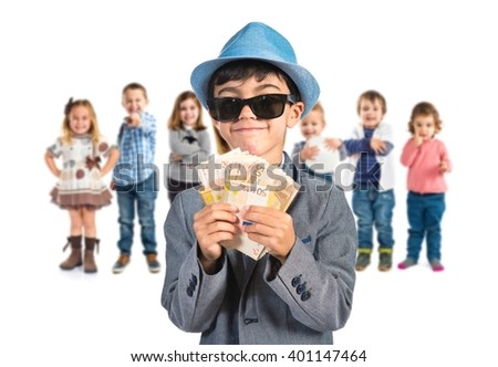 Little gangster holding a lot of money - stock photo