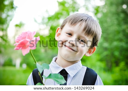 Little gentleman with rose - stock photo