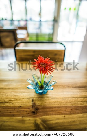 Little Gerbera flower on wooden table, Thailand