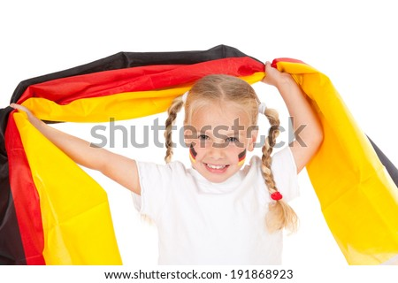 little german soccer fan waving a flag