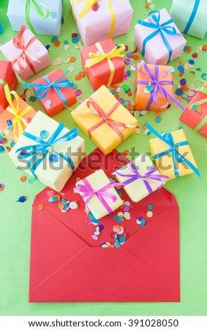 Little gift boxes with bows in colorful wrapping paper