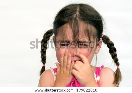 Little girl (age 4) cry,  isolated on white background. concept photo of child care, childhood, education, emotion, behavior,psychology. - stock photo