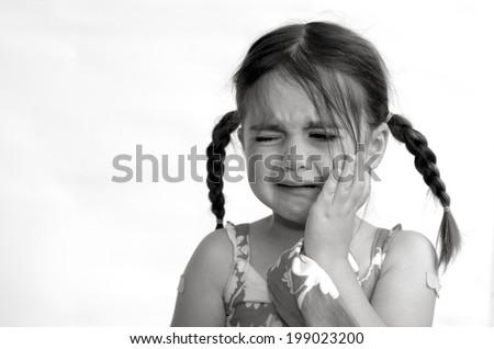 Little girl (age 4) cry,  isolated on white background. concept photo of child care, childhood, education, emotion, behavior,psychology.(BW) - stock photo