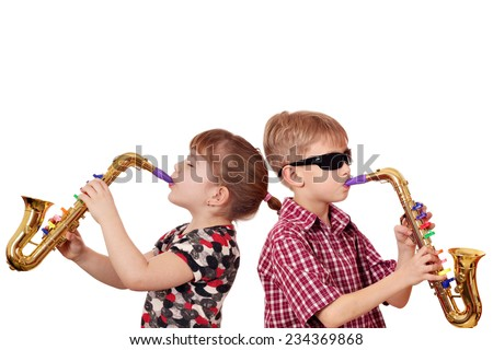 little girl and boy playing saxophone - stock photo