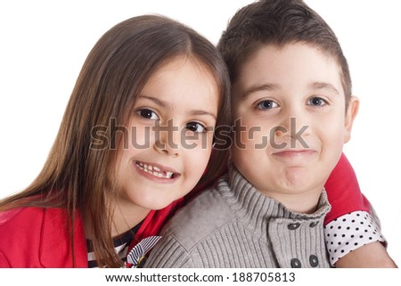 little girl and boy smiling