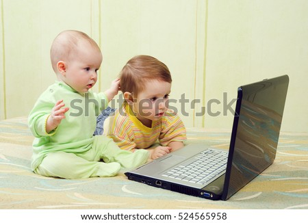 Little girl and boy using laptops.kids playing computer games