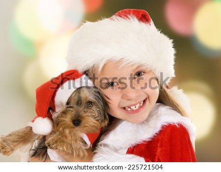 Little girl and dog at Christmas - stock photo