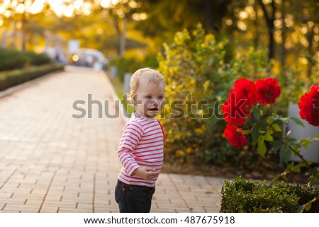 Little girl and flowers of roses