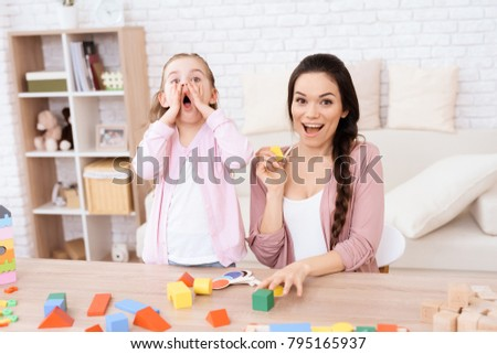 Little girl and girl make a grimace. They plaing at home. It's mom an daughter.