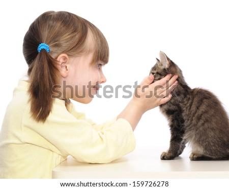 little girl and grey kitten on white background - stock photo