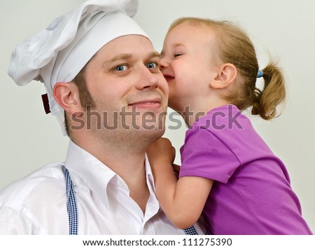 Little girl and her father having fun in the kitchen - stock photo