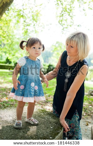Little girl and her mother - stock photo