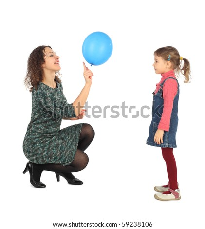 little girl and her mother playing with blue balloon side view isolated on white - stock photo