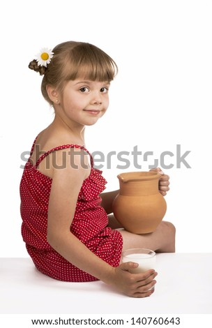 Little girl and milk isolated on white background
