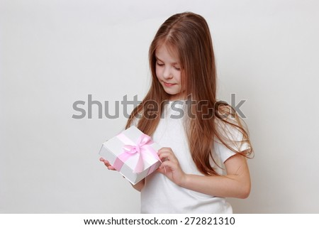 Little girl and present box - stock photo