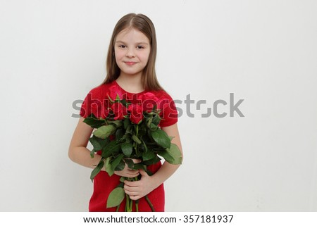 Little girl and red roses