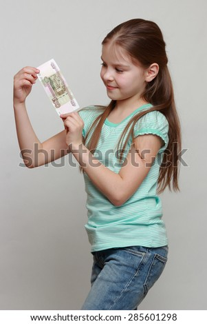 Little girl and russian money