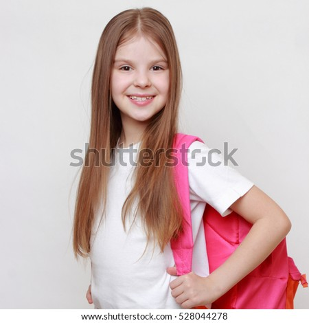 Little girl and school bag