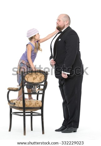 Little Girl and Servant in Tuxedo Have Fun, on white background