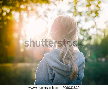 little girl and sunset - stock photo