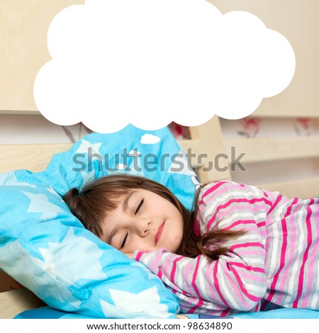 little girl asleep in her bed and dreams - stock photo