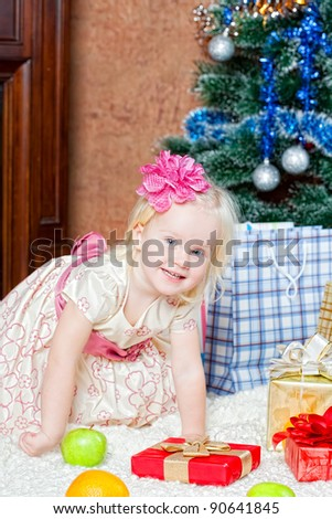 little girl at a Christmas fir-tree
