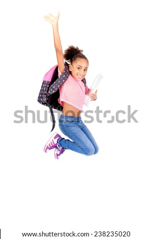 little girl at school jumping isolated in white - stock photo