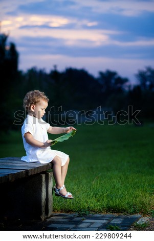 Little girl at sunset Cute girl in the park - stock photo