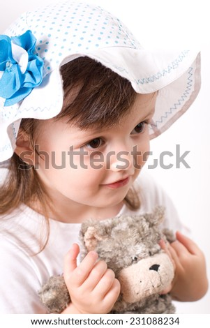 Little girl at the age of 2-4 years old closeup portrait with a toy - stock photo