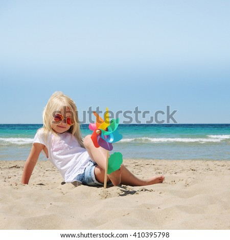 Little girl at the beach. Summer vacation concept