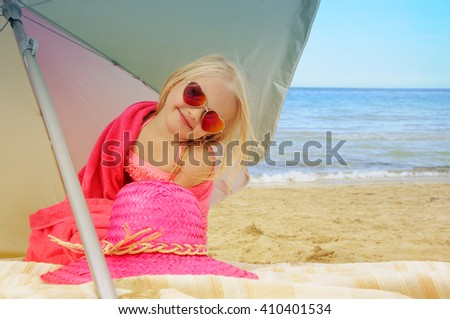Little girl at the beach. Summer vacation concept - stock photo
