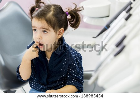 Little girl at the dentist - stock photo