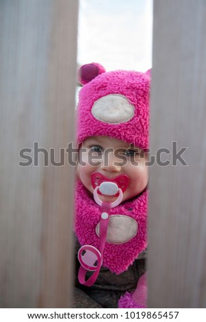 little girl at the playground palying hide and seek