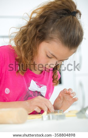 Little girl baking at home