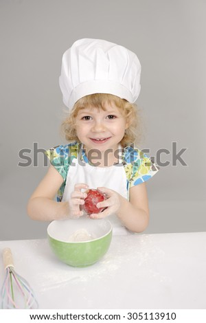 little girl  baking bread - stock photo