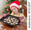 Little girl baking Christmas cookies - stock photo