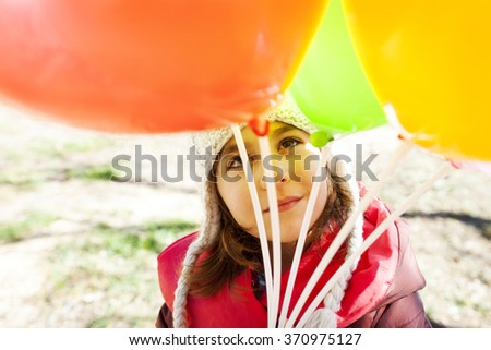 little girl balloons portrait