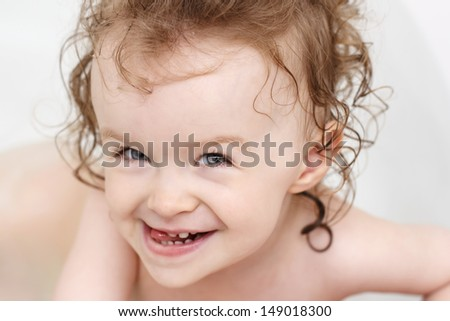 Little girl bathing and having fun - stock photo