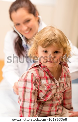 Little girl being examine with stethoscope by pediatrician