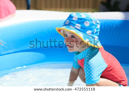 little girl being sun smart by wearing her hat