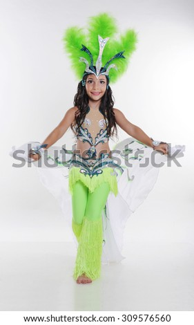 Little girl bellydancer in green costume portrait