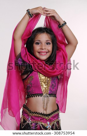 Little girl bellydancer in pink and black costume with shawlportrait
