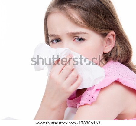Little girl blowing her nose - isolated on background.