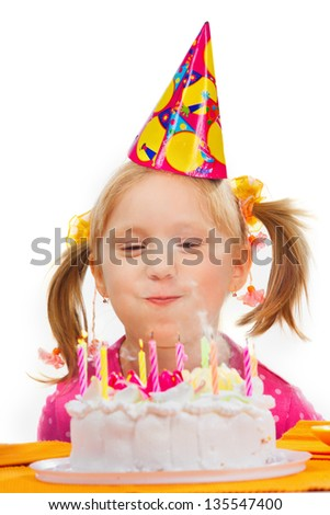 Little girl blowing out candles in her birthday - stock photo