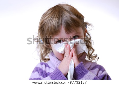 little girl blows her nose